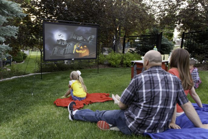 Halloween movie night on an outdoor movie screen