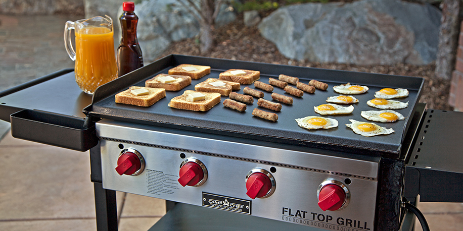French toast, sausage, and egg cooking on a Flat Top Grill